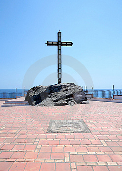 Religious cross set in rocks on a large terrace Royalty Free Stock Photography