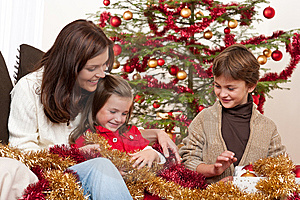 Christmas: mother with son and daughter Stock Image