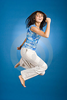 Jumping happy woman Stock Photos