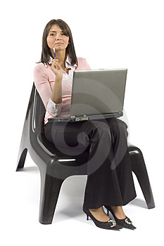 Woman sitting; working computer Free Stock Photography