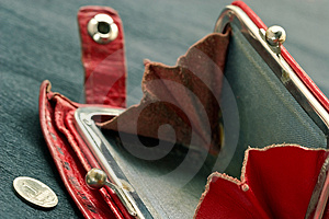 Shabby purse with coin Royalty Free Stock Photos