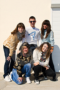 Group of five smiling young people Stock Photography