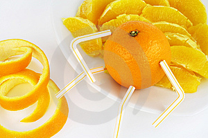 Orange And Orange Segments On A Plate Stock Photo - Image: 11634160