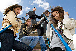 Group of five young people on the stairs Stock Images