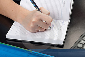 Young woman writing Stock Photography