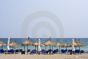 Organized Beach With Straw Umbrellas Stock Image - Image: 1171641