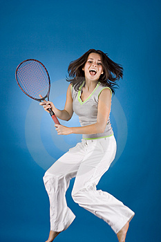 Happy woman with tennis racket Royalty Free Stock Photography