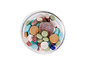 Fifty Cents In Saucer Full Of Pills Royalty Free Stock Image - Image: 11724926