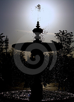 Silhouette Of Waterfountain Stock Photos