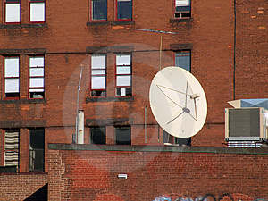 Satellite On Brick Free Stock Image