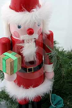 Santa Nutcracker on Pine Stock Photo