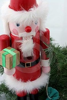 Santa Nutcracker On Pine Stock Photo