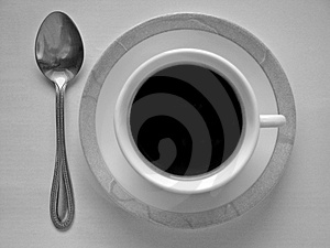 Cup of coffee and spoon Royalty Free Stock Photography