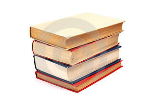 Hromadu knih na bílém pozadí.