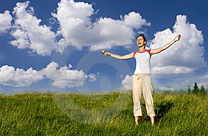 Young happy woman in meadow Stock Photos
