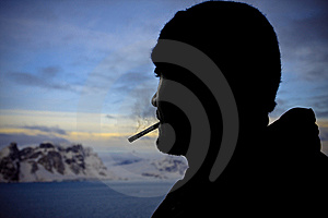 Silhouette Of Male Smokers Stock Photo - Image: 12599430