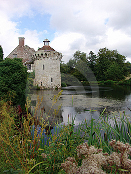 Castle Tower Viewed From Across Moat Royalty Free Stock Image - Image: 1284466