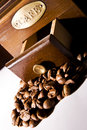 Vintage coffee grinder and coffee beans Royalty Free Stock Photography