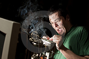 Man repairing computer on fire