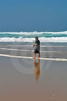 She Continues Walking On The Beach Royalty Free Stock Images - Image: 1297109