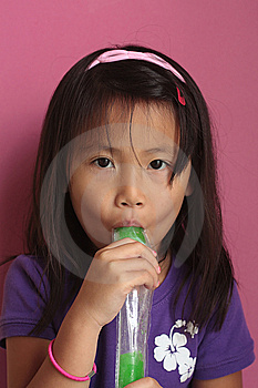 Asian Girl Eating Ice Pop Stock Image - Image: 12912151