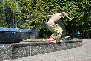 Rollerblader Doing A Trick Stock Image - Image: 12953101