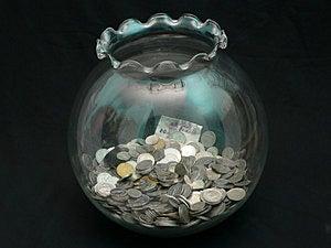 Coin in Jar Stock Photo