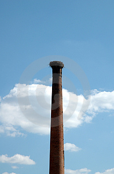 Stork nest in a old factory chimney Royalty Free Stock Images