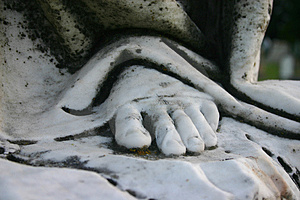 Stone Foot Of An Angel Sculpture Stock Image - Image: 1302621