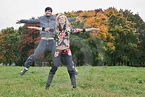 Autumn Couple Jump Stock Photography - Image: 1306842