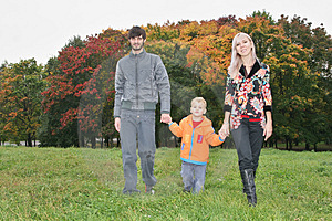 Autumn family walk Stock Photos