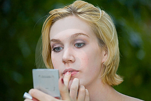 Beautiful Yong Blonde Girl With Blue Eyes Putting On Makeup Royalty Free Stock Photos - Image: 1318218