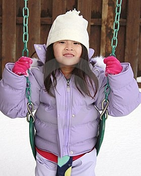 Asian Girl Playing In Snow Stock Image - Image: 13230221