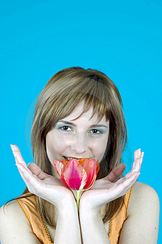 Smiling Behind A Tulip Royalty Free Stock Photo - Image: 1341485