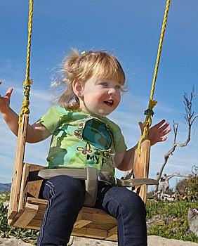 Swinging Little Girl Stock Image - Image: 13532121