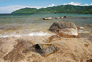 Rocks On A Serene Beach Stock Image - Image: 13562441
