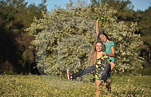 Two Beautiful Young Women Piggy-backing In Meadow Royalty Free Stock Images - Image: 13567309