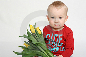 Boy With Flowers For Mummy Stock Image - Image: 13573901