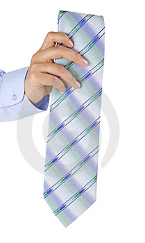 Man's Hand Presenting A Folded Tie Royalty Free Stock Photography - Image: 13575187