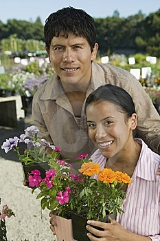 Couple Shopping At Plant Nursery Royalty Free Stock Images - Image: 13583939