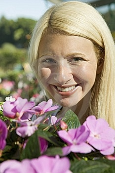 Woman Holding Flowers Stock Photos - Image: 13583963