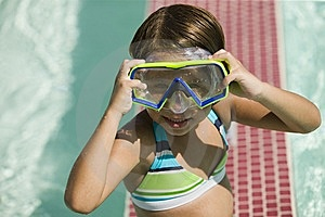 Girl (7-9) Adjusting Goggles Stock Photos - Image: 13583973