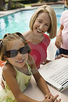 Two Girls Using Laptop With Grandmother Stock Photos - Image: 13583993