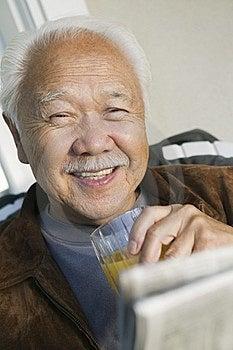 Man Drinking Orange Juice Royalty Free Stock Photo - Image: 13584135