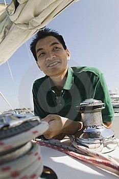Man On Sailboat Royalty Free Stock Photography - Image: 13584147