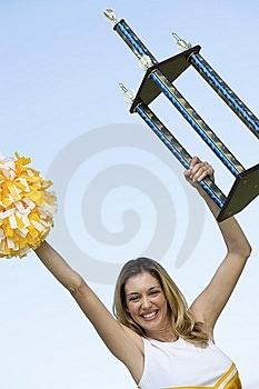 Smiling Cheerleader Holding Trophy Royalty Free Stock Photo - Image: 13584665