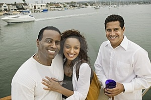 Couple With Friend On Yacht Stock Image - Image: 13584791