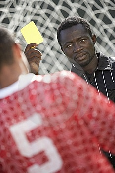 Soccer Referee Holding Out Yellow Card Stock Photos - Image: 13585083