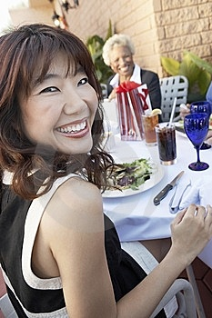 Smiling Woman Having Lunch With Friends Stock Image - Image: 13585171