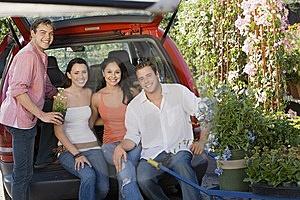 Two Young Couples Sitting In Open Car Trunk Stock Photography - Image: 13585172